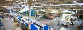 VANDENHOVE, spécialistes de l'ennoblissement textile mécanique. Traitements secs, contre-collage, transfert, adhésivage, découpe de toutes matières souples.